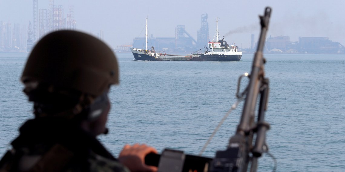 FILE PHOTO: A U.S. Navy soldier onboard Mark VI Patrol Boat stands guard as an oil tanker makes its way towards Bahrain port, during an exercise of U.S./UK Mine Countermeasures (MCMEX) taking place in Arabian Sea, Bahrain, September 11, 2018.  REUTERS/Hamad I Mohammed