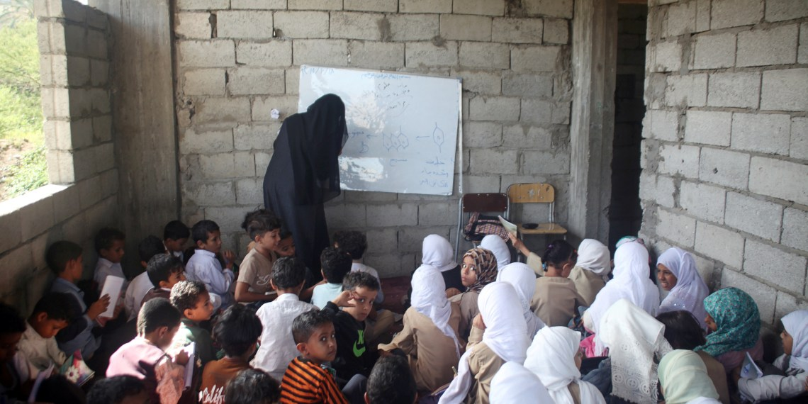 Students attend a class at the teacher's house, who turned it into a makeshift free school that hosts 700 students, in Taiz, Yemen October 18, 2018. Picture taken October 18, 2018. REUTERS/Anees Mahyoub