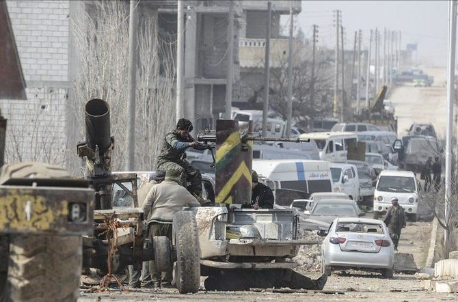 Turkish forces fired howitzer shells across the border into Syria's Ayn Al-Arab region, above, on Wednesday, killing four Kurdish militants. (AFP)