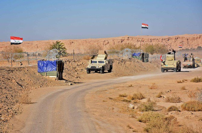 Iraqi forces gather near the Al-Qaim border crossing between Syria and Iraq, as troops reinforced their positions along the porous frontier with neighboring war-torn Syria. (AFP)