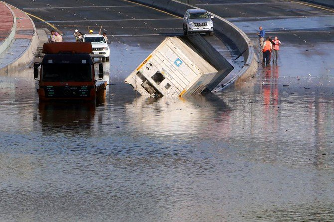 Municipality workers try to drain a flooded underpass in Kuwait City on November 6, 2018, as a result of the accumulation of rainwater. (AFP)