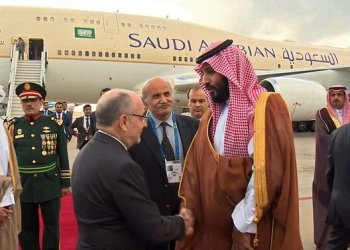 An image grab from a handout video released by the Saudi Broadcast Authority on November 28, 2018 shows Argentinian Foreign Minister Jorge Marcelo Faurie (L) welcoming Saudi Crown Prince Mohammed bin Salman (R) at an airport on the outskirts of Buenos Aires. (AFP)