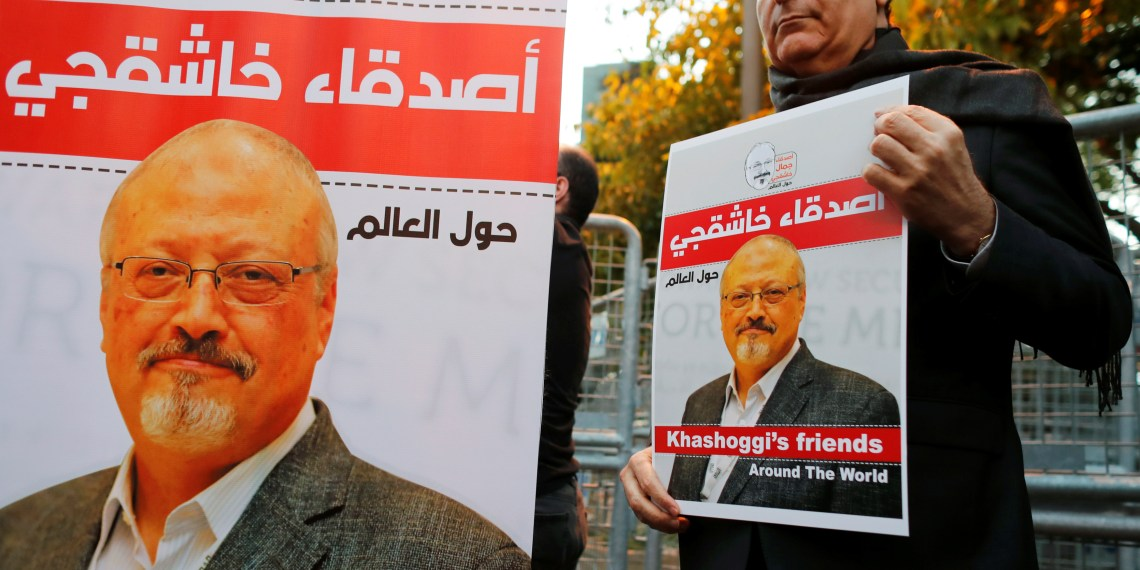FILE PHOTO: Friends of Saudi journalist Jamal Khashoggi hold posters and banners with his pictures during a demonstration outside the Saudi Arabia consulate in Istanbul, Turkey October 25, 2018. REUTERS/Osman Orsal