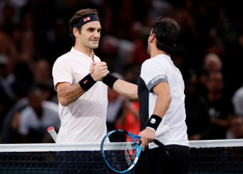 Tennis - ATP 1000 - Paris Masters - AccorHotels Arena, Paris, France - November 1, 2018 Switzerland's Roger Federer shakes hands with Italy's Fabio Fognini after winning their third round match REUTERS/Gonzalo Fuentes