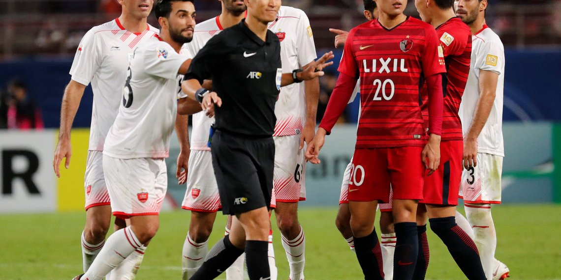 Soccer Football - Asian Champions League - Final - First Leg - Kashima Antlers v Persepolis FC - Kashima Soccer Stadium, Kashima, Japan - November 3, 2018  Persepolis FC's Siamak Nemati reacts after being sent off by referee Ma Ning  REUTERS/Toru Hanai