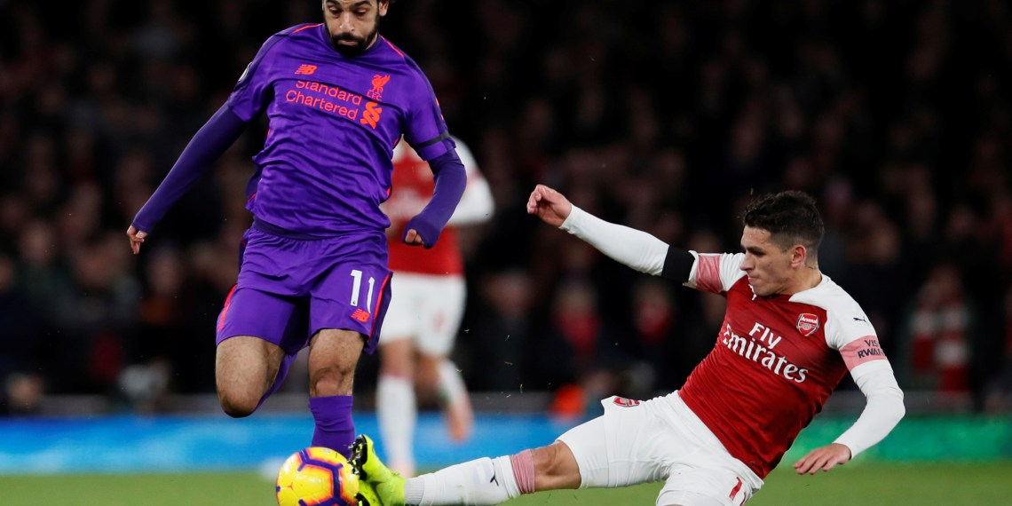 Soccer Football - Premier League - Arsenal v Liverpool - Emirates Stadium, London, Britain - November 3, 2018 Liverpool's Mohamed Salah in action with Arsenal's Lucas Torreira REUTERS/David Klein