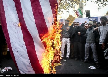 Iranian people burn the U.S. flag as they mark the anniversary of the seizure of the U.S. Embassy, in Tehran, Iran, November 4, 2018. Tasnim News Agency /Handout via REUTERS