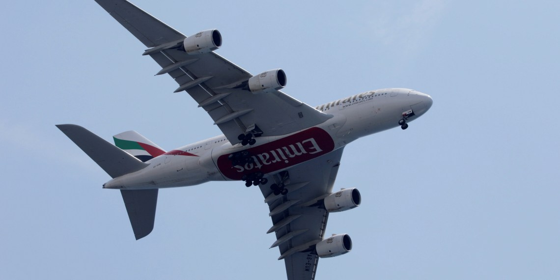 FILE PHOTO: An Emirates Airlines Airbus A380 passenger jet flies overhead near the Airport in Nice, France, August 3, 2018. REUTERS/Eric Gaillard/File Photo