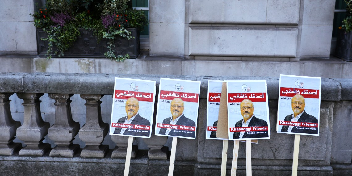 Placards can be seen outside the embassy as people protest against the killing of journalist Jamal Khashoggi in Turkey outside the Saudi Arabian Embassy in London, Britain, October 26 2018. REUTERS/Simon Dawson