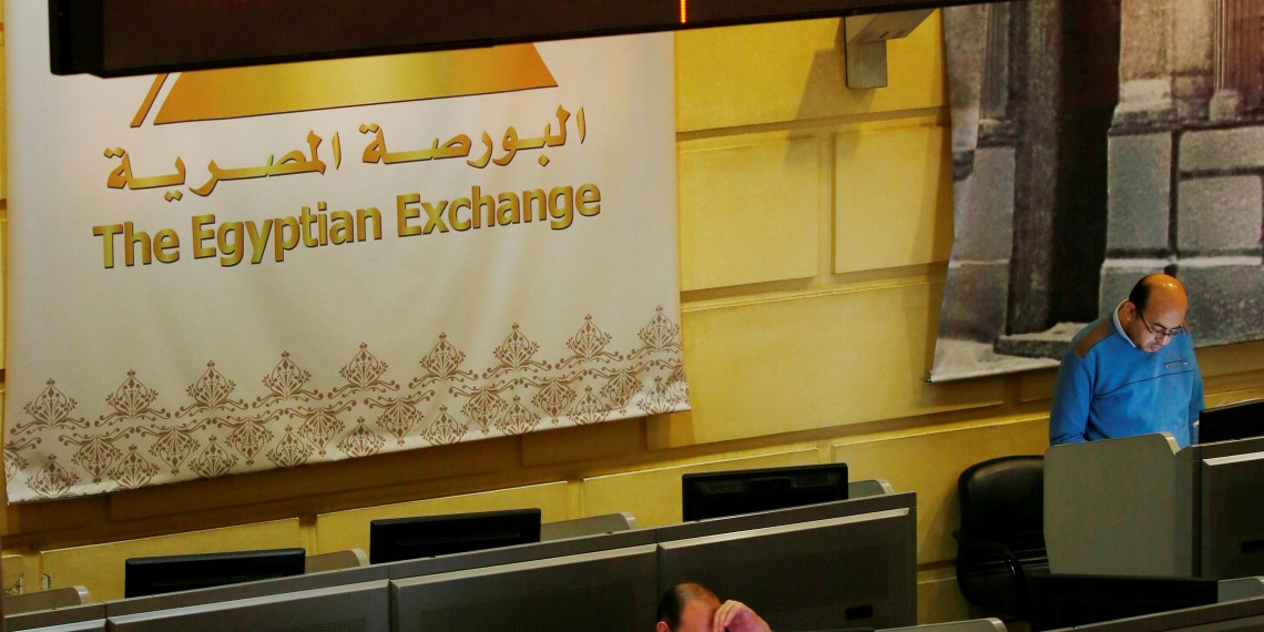 FILE PHOTO: Traders work at the Egyptian stock exchange in Cairo, Egypt February 6, 2018. REUTERS/Amr Abdallah Dalsh