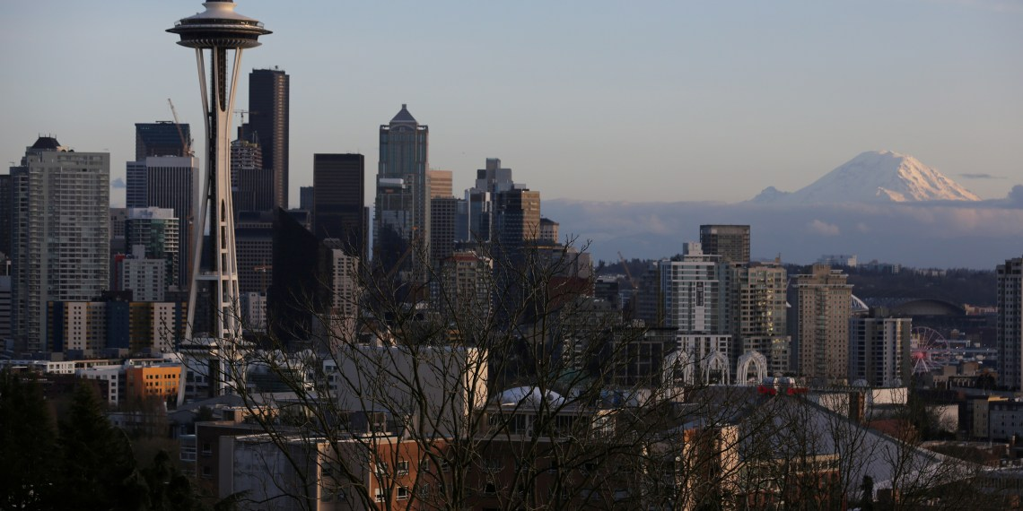 FILE PHOTO: The Space Needle and Mount Rainier are seen on the skyline of Seattle, Washington, U.S. February 11, 2017.  REUTERS/Chris Helgren/File Photo