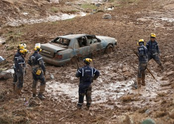 Civil defense members look for missing persons after rain storms unleashed flash floods, in Madaba city, near Amman, Jordan, November 10, 2018. REUTERS/Muhammad Hamed