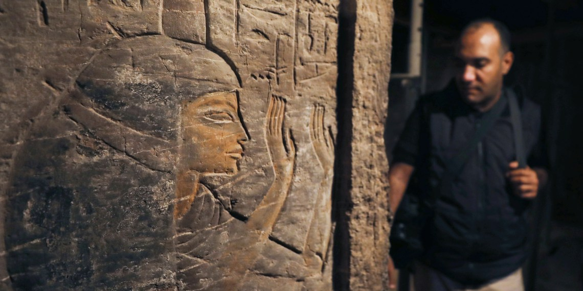A visitor observes the wall of a Khufu-Imhat tomb, at the Saqqara area near its necropolis, in Giza, Egypt November 10, 2018. REUTERS/Mohamed Abd El Ghany