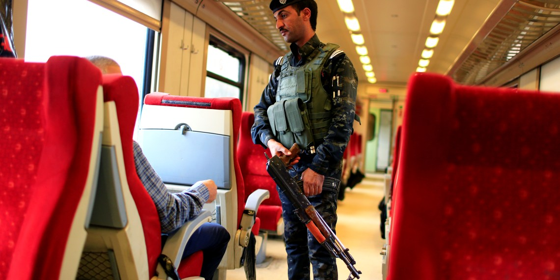 An Iraqi Policeman stands guard in a passenger cabin of the train on the way to Fallujah after leaving Baghdad Railway Station, the newly resurrected service to the city, in Baghdad, Iraq November 7, 2018. REUTERS/Thaier al-Sudani