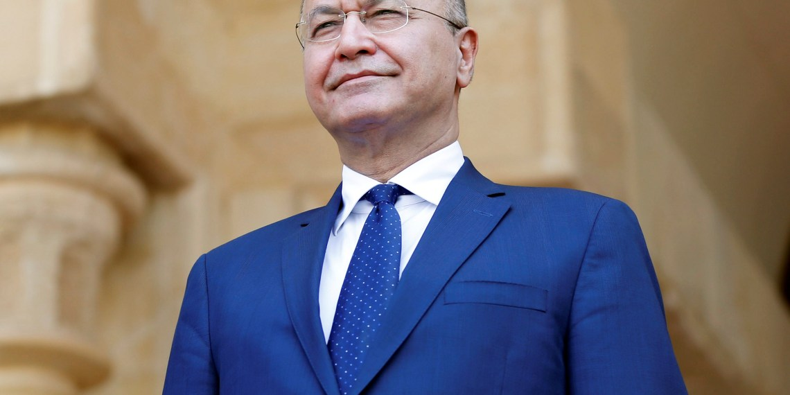 FILE PHOTO: Barham Salih, Iraq's newly elected President stands during a handover ceremony at Salam Palace in Baghdad, Iraq October 3, 2018. REUTERS/Thaier Al-Sudani
