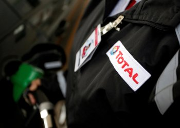 FILE PHOTO: The logo of French oil giant Total is seen on the uniform of an employee at its first gas station in Mexico City, Mexico January 25, 2018. REUTERS/Daniel Becerril