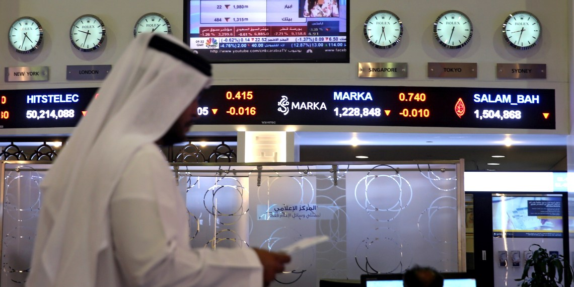 FILE PHOTO: Traders monitor stock information at Dubai Financial Market, in Dubai, United Arab Emirates, June 5, 2017. REUTERS/Stringer