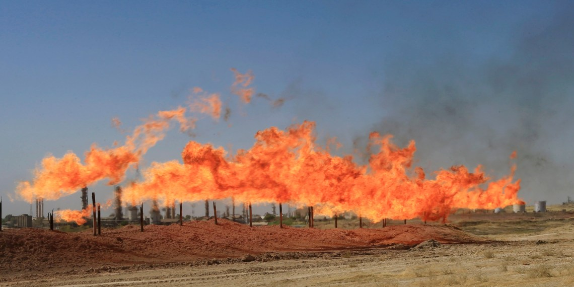 FILE PHOTO: Flames emerge from flare stacks at the oil fields in Kirkuk, Iraq October 18, 2017. REUTERS/Alaa Al-Marjani