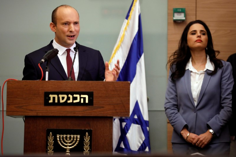 Israeli Education Minister Naftali Bennett and Justice Minister Ayelet Shaked deliver statements to members of the media, at the Knesset, Israel's parliament, in Jerusalem November 19, 2018. REUTERS/Amir Cohen