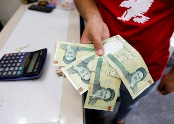 FILE PHOTO: A vendor inspects Iranian rials at a currency exchange shop in Baghdad, Iraq, August 8, 2018. REUTERS/Khalid Al-Mousily