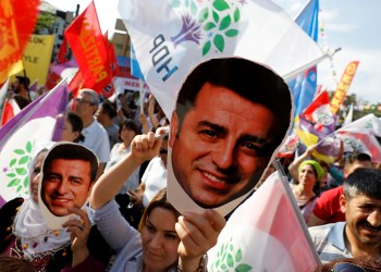 FILE PHOTO: Supporters of Turkey's main pro-Kurdish Peoples' Democratic Party (HDP) hold masks of their jailed former leader and presidential candidate Selahattin Demirtas during a rally in Ankara, Turkey, June 19, 2018. REUTERS/Umit Bektas