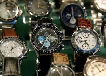 FILE PHOTO: A used Omega Speedmaster Professional wristwatch (C) is displayed with watches of different brands in the window of a shop in Zurich, Switzerland January 22, 2018. REUTERS/Arnd Wiegmann