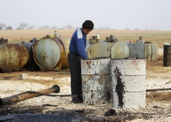 FILE PHOTO: A youth works at a makeshift oil refinery site in Marchmarin town, southern countryside of Idlib, Syria December 16, 2015. REUTERS/Khalil Ashawi