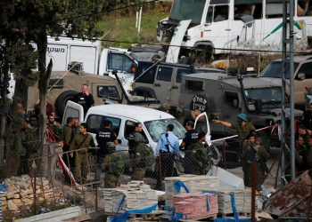Israeli security forces secure the scene of what the Israeli army said was a car-ramming attack near Beit Ummar in the occupied West Bank November 26, 2018. REUTERS/Ammar Awar