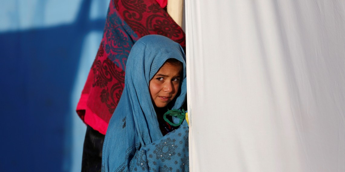 An internally displaced Afghan girl stands outside her tent at a refugee camp in Herat province, Afghanistan October 14, 2018. Picture taken October 14, 2018. REUTERS/Mohammad Ismail - RC1633CE5420