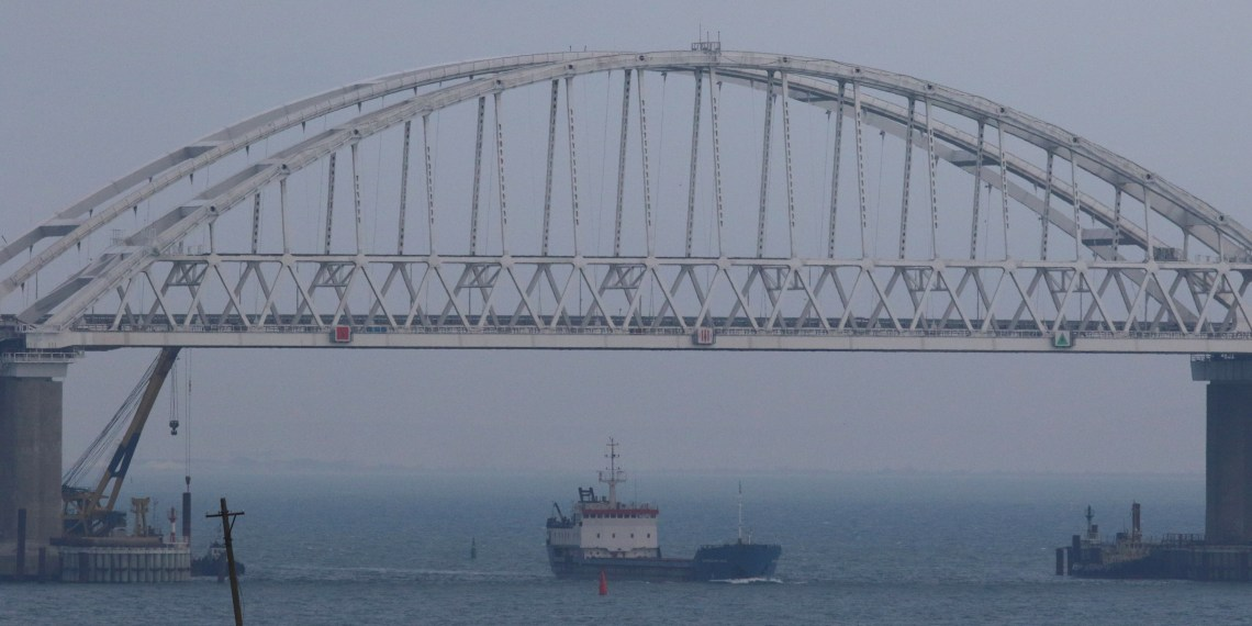 FILE PHOTO: A vessel sails under a bridge connecting the Russian mainland with the Crimean Peninsula across the Kerch Strait, Crimea November 26, 2018. REUTERS/Pavel Rebrov
