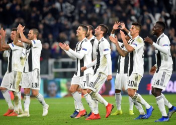 Soccer Football - Champions League - Group Stage - Group H - Juventus v Valencia - Allianz Stadium, Turin, Italy - November 27, 2018 Juventus' Cristiano Ronaldo, Joao Cancelo and team mates applaud the fans at the end of the match REUTERS/Massimo Pinca