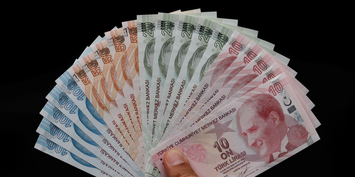 FILE PHOTO: Turkish lira banknotes are seen in this picture illustration in Istanbul, Turkey August 14, 2018. REUTERS/Murad Sezer/Illustration