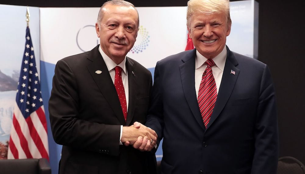Turkey's President Recep Tayyip Erdogan posing with US President Donald Trump during the G20 summit in Buenos Aires, Argentina. (AFP/Turkish Presidential Press Service)