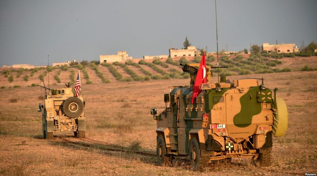 Turkish and U.S. troops are pictured during a joint patrol in Manbij area, northern Syria, Nov. 8, 2018. (Turkish Defense Ministry/Turkish Military/Reuters)