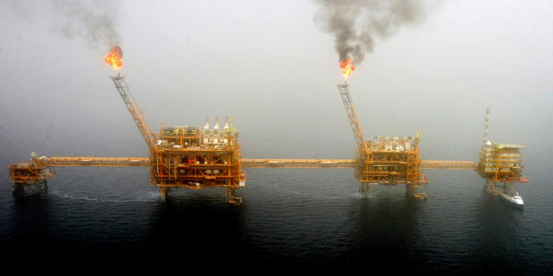 FILE PHOTO: Gas flares from an oil production platform at the Soroush oilfields in the Persian Gulf, south of the Iranian capital Tehran, July 25, 2005.  REUTERS/Raheb Homavandi