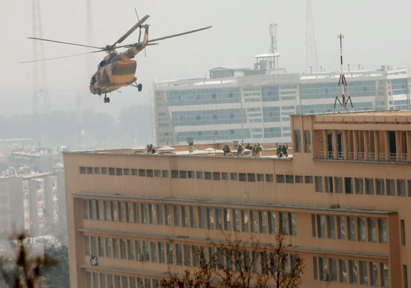 FILE PHOTO: Afghan National Army (ANA) soldiers descend from helicopter on a roof of a military hospital during gunfire and blast in Kabul, Afghanistan March 8, 2017.REUTERS/Mohammad Ismail
