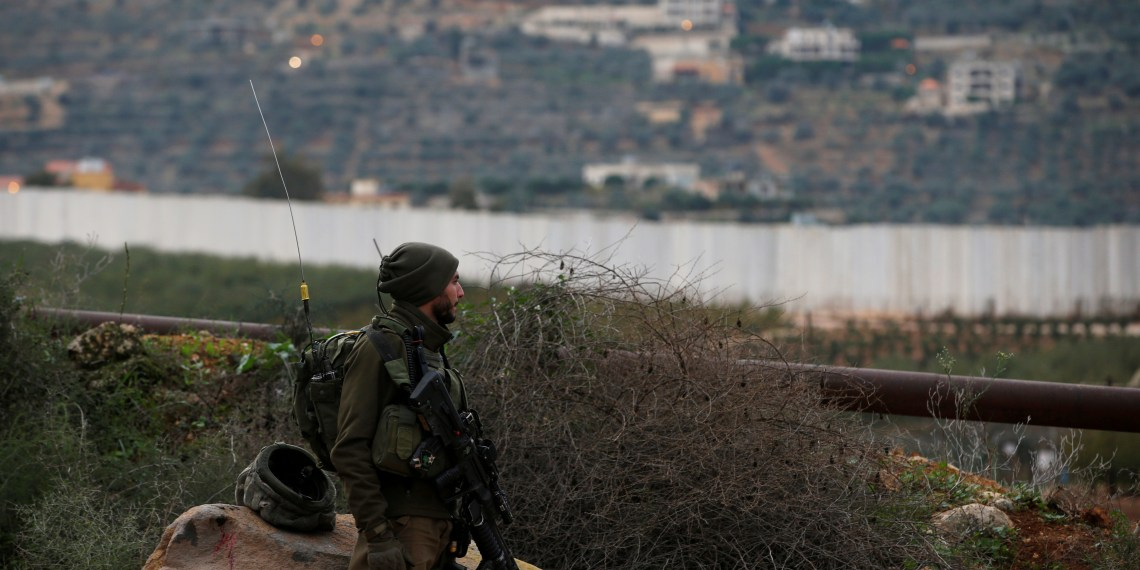 """FILE PHOTO: An Israeli soldier guards near the border with Lebanon, the morning after the Israeli military said it had launched an operation to """"expose and thwart"""" cross-border attack tunnels from Lebanon, in Israel's northernmost town Metula December 5, 2018. REUTERS/Ronen Zvulun/File Photo"""
