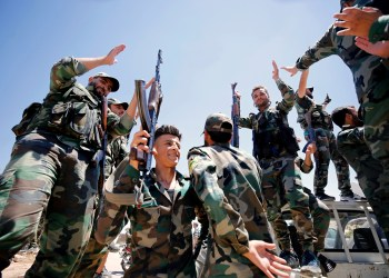 FILE PHOTO: Syrian army soldiers gesture as they hold their weapons in Quneitra, Syria, July 27, 2018. REUTERS/Omar Sanadiki/File Photo