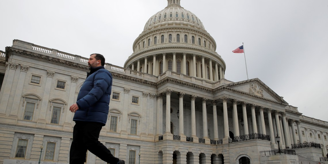 A man walks past the U.S. Capitol building as a partial government shutdown continues in Washington, U.S., January 7, 2019. REUTERS/Jim Young