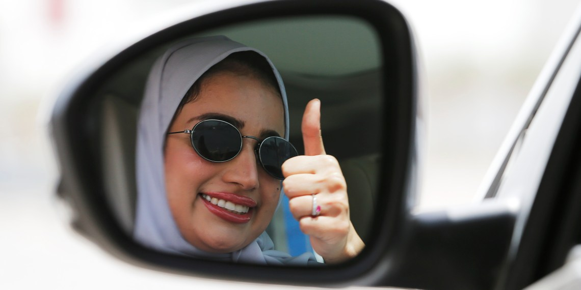 A woman gestures as she drives her car in Dhahran, Saudi Arabia, June 24, 2018. REUTERS/Hamad I Mohammed