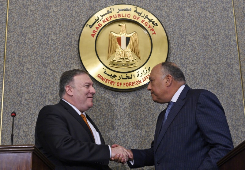 U.S. Secretary of State Mike Pompeo shakes hands after holding a press conference with Egyptian Foreign Minister Sameh Shoukry at the ministry of foreign affairs in Cairo, Egypt, January 10, 2019. Andrew Caballero-Reynolds/Pool via REUTERS