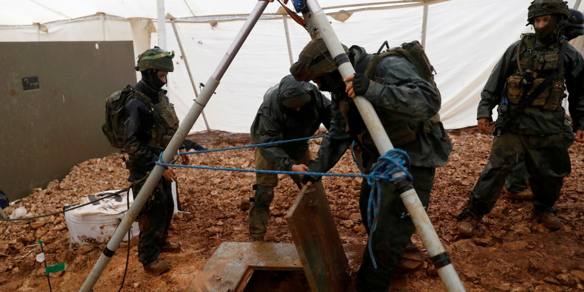 FILE PHOTO: Israeli soldiers lift the cover of an Israeli-dug hole into a cross-border tunnel dug from Lebanon into Israel, as seen on the Israeli side of the border, near the town of Metula December 19, 2018 REUTERS/ Ronen Zvulun/File Photo