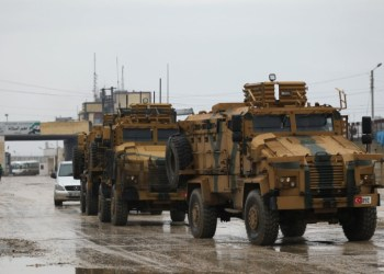 Turkish military vehicles ride at the Bab el-Salam border crossing between the Syrian town of Azaz and the Turkish town of Kilis, in Syria January 1, 2019. REUTERS/Khalil Ashawi