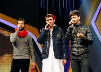 """FILE PHOTO: Afghan singer Abdul Salam Maftoon, 28, (C) performs during rehearsals in the """"Afghan Star"""" talent show at Tolo television studio in Kabul, Afghanistan January 16, 2019. REUTERS/Mohammad Ismail"""