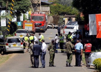 Kenyan policemen and explosives experts gather evidence from the car suspected to have been used by the attackers outside the scene where explosions and gunshots were heard at The DusitD2 complex, in Nairobi, Kenya January 17, 2019. REUTERS/Njeri Mwangi