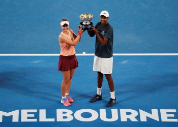 Tennis - Australian Open - Mixed Doubles Final - Melbourne Park, Melbourne, Australia, January 26, 2019 Czech Republic's Barbora Krejcikova and Rajeev Ram of the U.S. pose with the trophy after winning the match against Australia's John-Patrick Smith and Astra Sharma REUTERS/Kim Kyung-Hoon