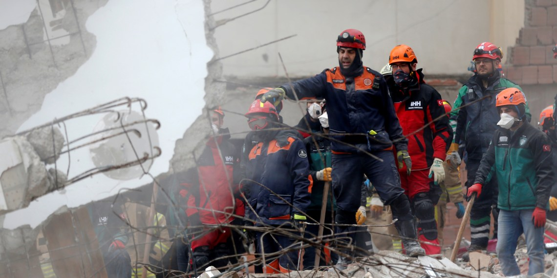 Rescue workers are seen at the site of a collapsed residential building in the Kartal district, Istanbul, Turkey, February 7, 2019. REUTERS/Kemal Aslan