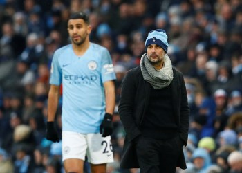 """Soccer Football - Premier League - Manchester City v Everton - Etihad Stadium, Manchester, Britain - December 15, 2018  Manchester City manager Pep Guardiola and Riyad Mahrez look on   Action Images via Reuters/Jason Cairnduff  EDITORIAL USE ONLY. No use with unauthorized audio, video, data, fixture lists, club/league logos or """"live"""" services. Online in-match use limited to 75 images, no video emulation. No use in betting, games or single club/league/player publications.  Please contact your account representative for further details."""
