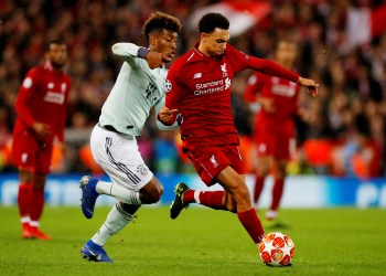 Soccer Football - Champions League - Round of 16 First Leg - Liverpool v Bayern Munich - Anfield, Liverpool, Britain - February 19, 2019  Liverpool's Trent Alexander-Arnold in action with Bayern Munich's Kingsley Coman         REUTERS/Phil Noble