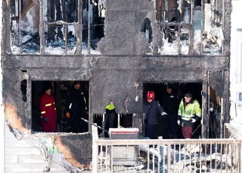Police and fire invetsigators are on the scene of a fatal house fire in the community of Spryfield in Halifax, Nova Scotia, Canada, February 19, 2019. REUTERS/Ted Pritchard